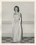 A Caucasian lady wearing a light colored dress with white designed above her waist by Lonnie W. Fleming Sr.