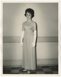 A Caucasian lady in a formal dress by Lonnie W. Fleming Sr.