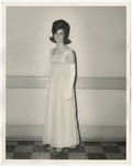 A Caucasian lady wearing a silk dress with white gloves that extend past her elbows by Lonnie W. Fleming Sr.