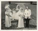 A bride standing beside her father in her wedding gown by Lonnie W. Fleming Sr.