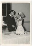 A bride is feeding her groom wedding cake by Lonnie W. Fleming Sr.
