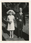 A bride standing beside her father by Lonnie W. Fleming Sr.