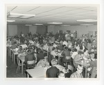 A cafeteria full of people eating pancakes by Lonnie W. Fleming Sr.