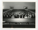 4 rows of elderly people sitting in a church by Lonnie W. Fleming Sr.