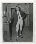 A boy wearing football leggings and a suit top by Lonnie W. Fleming Sr.