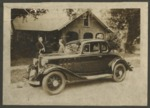 Black car in front of a house on Beaty Street by Horry County Historical Society