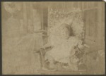 Young child in white clothes sitting in chair by Horry County Historical Society