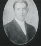 Man in a black suit wearing a white shirt by Horry County Historical Society