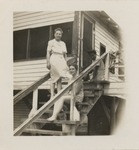 Rebecca Bryan sitting on the stairs of a porch. by Horry County Historical Society