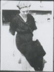 Woman wearing shower cap and dark colored robe. by Horry County Historical Society