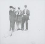 Men in a circle wearing suits, ties, and hats. by Horry County Historical Society