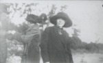 Women in dark colored coats and hats. by Horry County Historical Society