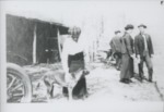 Boy wearing cap petting a dog by Horry County Historical Society