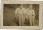 Two young girls sitting on ground by Horry County Historical Society
