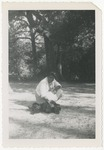 African American lady playing with dog by Horry County Historical Society