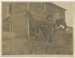 Lady in formal attire by her black horse and carriage. by Horry County Historical Society
