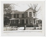 Unidentifiable white home with porch and brick columns. by Horry County Historical Society