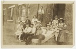 School class lounging around on front porch of school by Horry County Historical Society