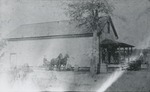 Side view of a building with horses and carriages outside. by Horry County Historical Society