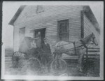 Photo of a man and woman in front of their home in Loris, S.C. by Horry County Historical Society