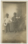 Dr. Joe Dusenberry's young helpers playing string instruments. by Horry County Historical Society